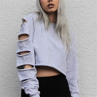 Ladies oversize distressed cut sleeve crop sweatshirt