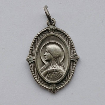Vintage Catholic Veiled Mary  Sacred Heart of Jesus on back  Stamped Sterling Pendant