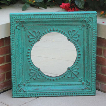 Exotic turquoise and bronze pounded metal wall mirror