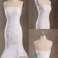 Mermaid strapless sleeveless floor-length tulle with appliques wedding dress