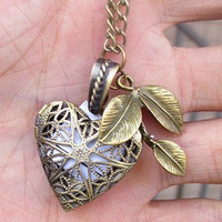 You love me. Real or not real. heart photo frame locket Necklace with tree leaf and a letter