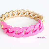 bright pink acrylic and chunky gold bracelet