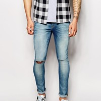 ASOS | ASOS Extreme Super Skinny Jeans With Knee Rips at ASOS