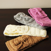 Handmade Knit Headband Earwarmer adorned with a bow of same color.