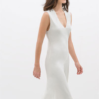 ASYMMETRIC HEM STUDIO DRESS