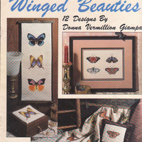"""Winged Beauties 12 counted cross stitch designs of butterflies 3"""" x 2"""" by Donna Giampa for pillow, blanket, bell pull Leisure Arts 2166"""