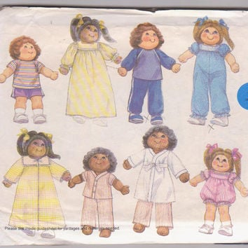 """Pattern for 8 complete outfits for 18"""" and 23"""" Cabbage Patch dolls including sleepwear, rompers, playwear McCall's 9091 CUT and COMPLETE"""