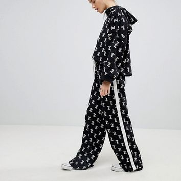 Juicy By Juicy Couture Multi Logo Hoodie & Wide Leg Trousers Co-Ord at asos.com