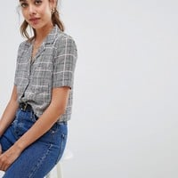Miss Selfridge sleeveless bowling shirt with pocket detail in check at asos.com