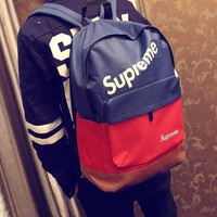 ABKUYOU Blue and Red Supreme Backpack