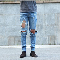 Skinny ripped denim jeans