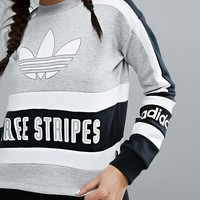 adidas Originals Cropped Sweatshirt With Three Stripe Block Logo at asos.com