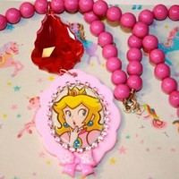 Princess Peach Super Mario Brothers necklace 80s toy cartoon Pastel fairy kei Mixed Media Art pendant By Niftyvintagegirl Vintagtoygal from Niftyvintagegirl