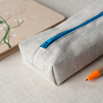 Natural linen pencil case with bright blue zip closure