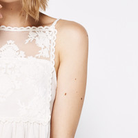 TOP LACE ESCOTE | Camisetas | Springfield
