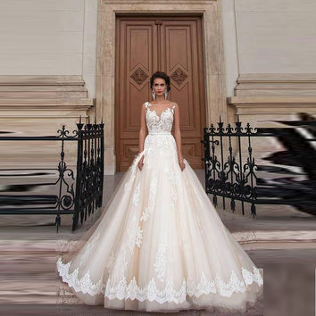 Stunning Vintage Sheer Castle Wedding Dresses 2017 Illusion Back Appliques Lace Chapel Train Bridal Gown For Western Style