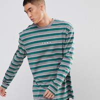 Puma Long Sleeve Striped Top In Green Exclusive To ASOS at asos.com