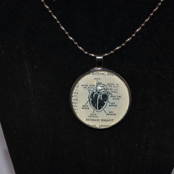 Human Heart round glass tile vintage dictionary necklace in a gunmetal pendant tray on a gunmetal dot dash chain