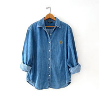 vintage button up jean shirt. washed out denim shirt. preppy button down shirt. worn in jean shirt.