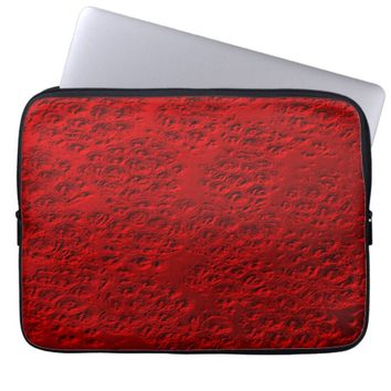 Damaged red metal laptop sleeve