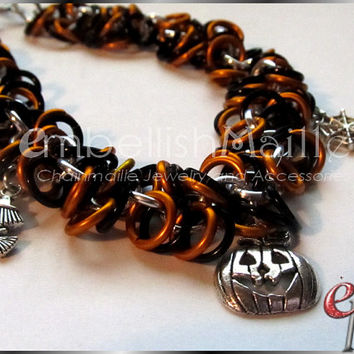 Halloween inspired Pumpkin, Witch, and spider charm accented Shaggy Loops Chainmaille bracelet. Fun for any Halloween party or Haunted House