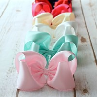 Satin 5 inch hair bows in navy, black, white, ivory, shocking pink,red,pin and mint on alligator clip or barrette