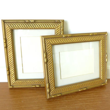 Two elegant gold wood picture frames with glass fronts and mats, 5 x 6 inches
