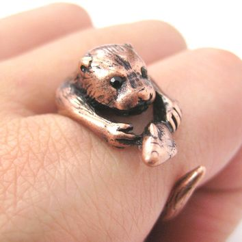 Realistic Otter Holding a Fish Shaped Animal Wrap Ring in Copper | US Sizes 4 to 9