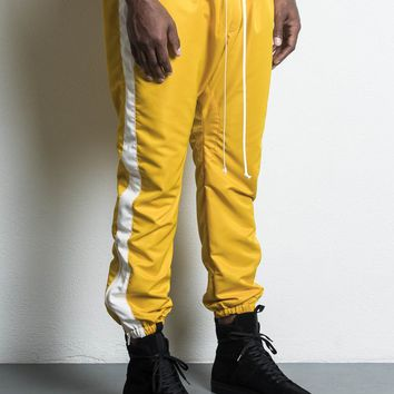 parachute track pant / yellow + ivory