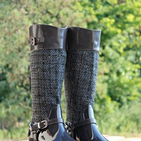 Our Write Your Name Boots are a must have for the fall! It's a rubber boot with knit detail to the shaft. Strap that wraps around the sole and has silver detail. Zipper located on the inside.