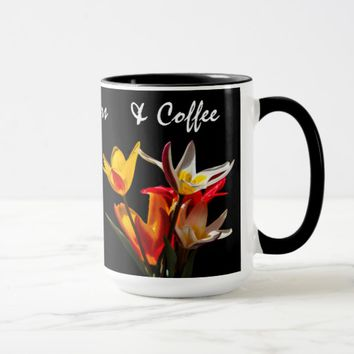 Tulip flowers against black background mug