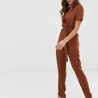 PrettyLittleThing jumpsuit with geo print in rust | ASOS