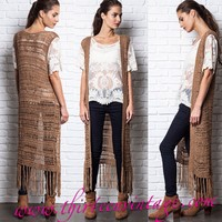 This super cool all year long semi-sheer soft knit/Woven crochet vest features an open front design, sleeveless, and completed with fringe bottom hem. Pair with skinny jeans, white tank top and cool ankle booties.