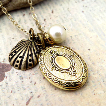 Small Oval Locket with Shell Charm and Pearl accent