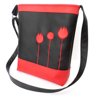 Tulipe appliqued faux leather purse in black and white