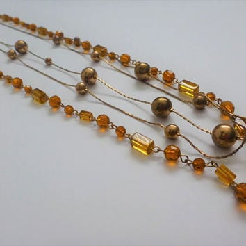 Amber Lucite Necklace. three strand amber necklace. long necklace. flapper necklace. multi strand necklace. beaded necklace