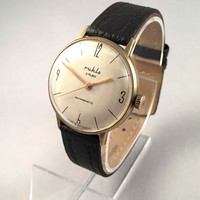 "Vintage East German GDR era men's watch called ""RUHLA"". Comes with new genuine leather band!"