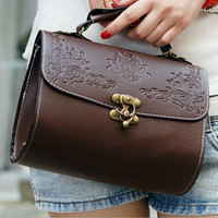 Carved flower flip satchel with metal catch