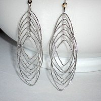 Silver multi loop earrings teardrop earrings dangle hoops rotating hoop earrings oval earrings