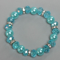 Blue children's handmade wrist bracelet with crystal and ceramic beads stretchy