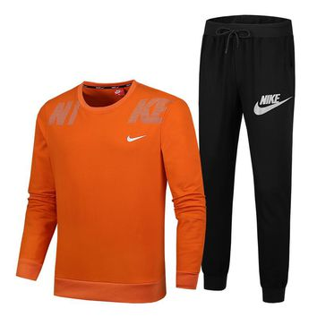 NIKE Autumn And Winter New Fashion Letter Hook Print Couple Sports Leisure Long Sleeve Top And Pants Two Piece Suit Orange