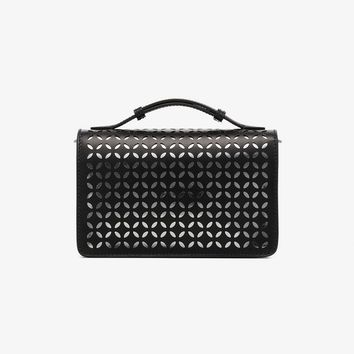 black laser cut top handle leather clutch