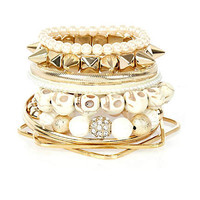Cream and gold tone skull bracelets