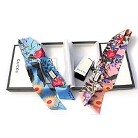 GUCCI New Flora print silk neck bow