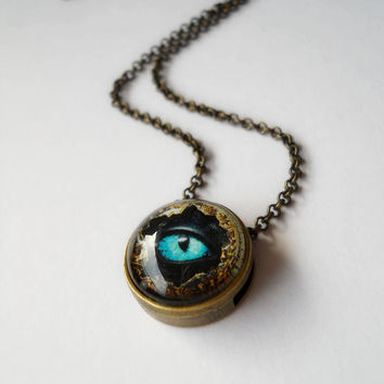 Turquoise  blue dragon eye glass pendant, glass jewelry, antique brass dragon necklace, tiny pendant, dragon pendant, dragon eye jewelry