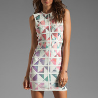 Talulah White Love High Neck Body-Con Mini Dress in Geometric Floral Print/White Bind from REVOLVEclothing.com