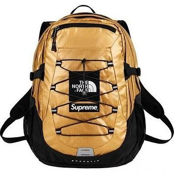 The North Face & Supreme New fashion couple high capacity backpack bag Golden