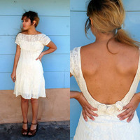 1990s. ivory lace stretchy dress with open back and flower appliques. m