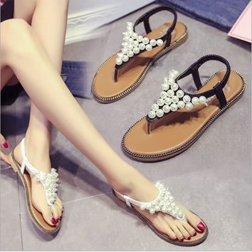 Brand women's sandals  summer beaded stone pearl female sandals Rome flat sandwich toe women's sandals flat wedding shoes
