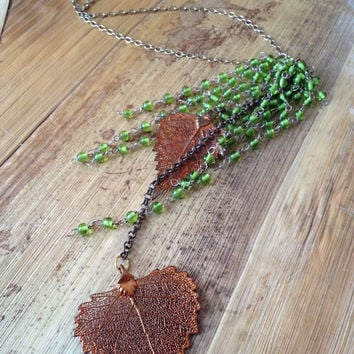 Copper leaves and green rosary beads.